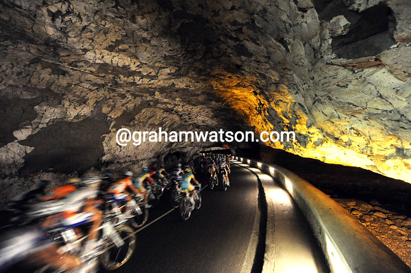 Cavemen of the Tour - the peloton speeds through the Grotto of Mas d'Azil in search of the first sprint...