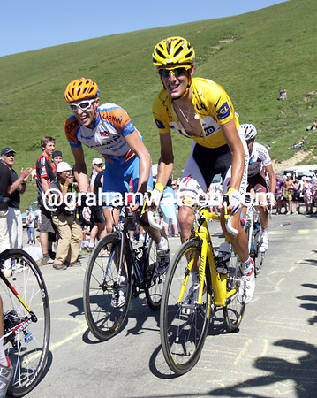 Schleck is about 30-seconds down near the summit, and he has Hesjedal alongside him...
