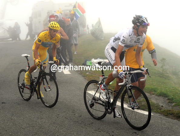 Schleck and Contador have passed Kolobnev with about eight-kilometres to go...