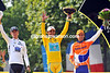 Alberto Contador celebrates his third Tour de France win with runner-up Andy Schleck and Denis Menchov, in third place...