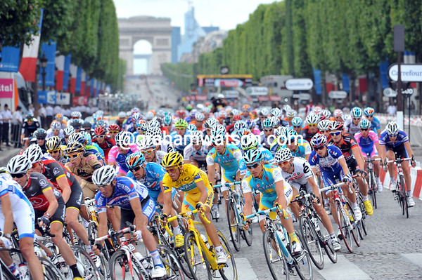 Contador is secured by Astana as the peloton sweeps into the Place de la Concorde...