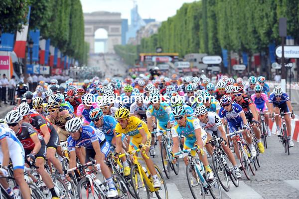 Contador is secured by Astana as the peloton sweeps into the Place de la Concorde...
