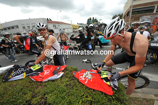 ...except that race officials refuse to allow it, despite the good cause - let's strip guys..!