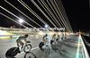 Spanish knights - Footon-Servetto races across one of Seville's futuristic bridges at nightime..