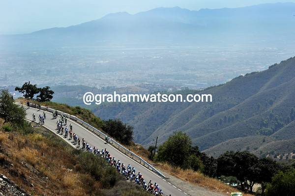 The peloton is in pursuit and cannot enjoy the stunning views above Malaga...