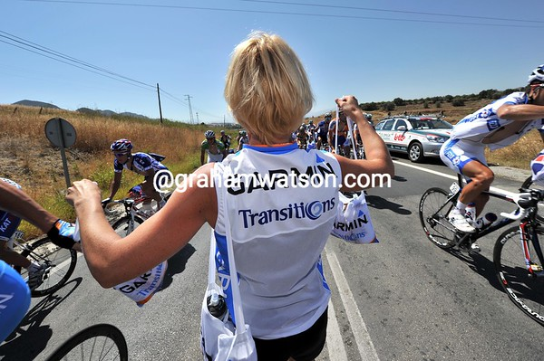 It's a tight squeeze in the feed-zone for Garmin soigneur...