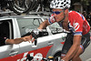 Thor Hushovd collects his and his teamates water bottles...
