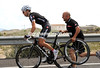 Clearly happy in their respective jobs, Phillip Deignan changes a wheel and gets a push from Alejandro Torralbo...
