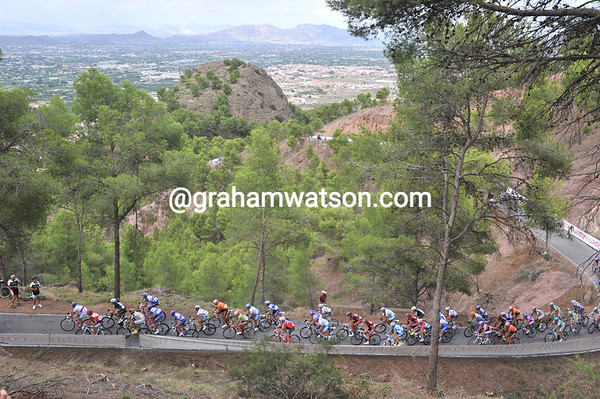There are still about 35 riders in the peloton on the Cresta del Gallo...