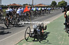 A recumbent cyclist is trying to keep pace with the fast-moving peloton...