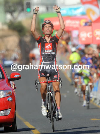 David Lopez has won stage nine after attacking on the descent into Alcoy...