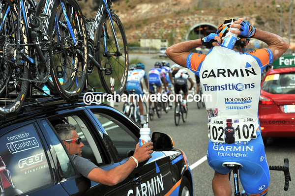 Julian Dean is collecting bottles from the unconventional right side of his team car...