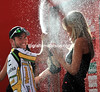 Now this is much better - Cavendish sprays 'Cava' over the podium girls..!
