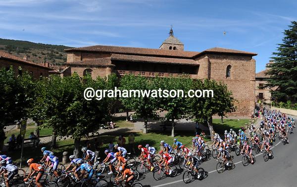 The peloton sweeps through the Riojan village of Ezcaray...