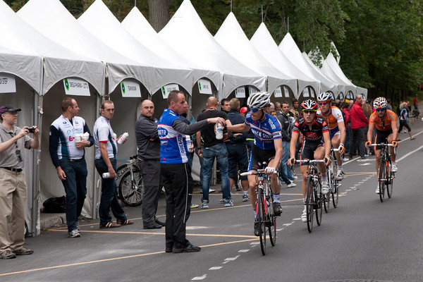 The feed zone looked like a row of stalls in a market; Seeldraeyers collects a bottle.