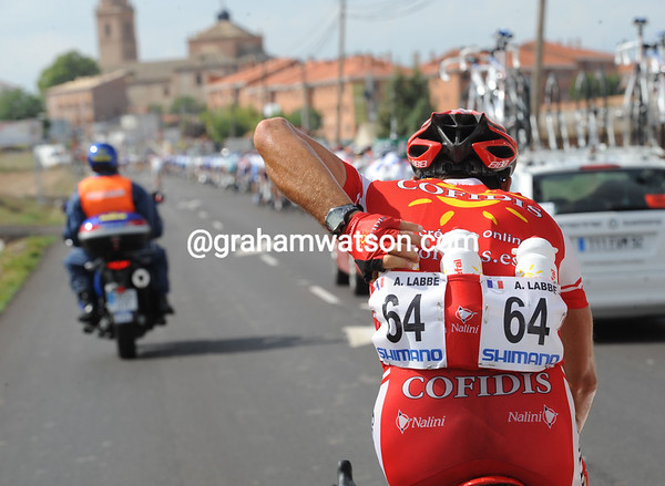 Long days require long drinks - Arnaud Labbe fills up at the back of the race...
