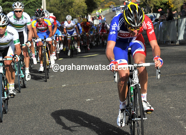 Alex Dowsett is caught by the peloton after trying to go with Moser...