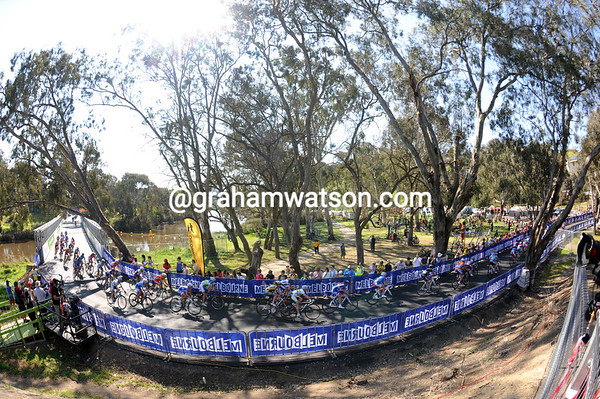 A chasing group races after the leaders at the Bailey bridge over the Barwon River...