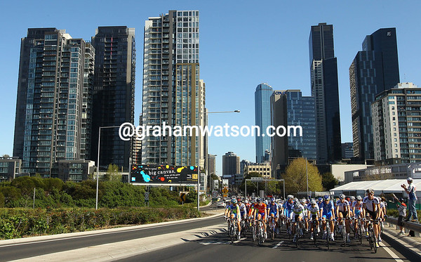 The peloton rides out of Melbourne in the neutralised zone...