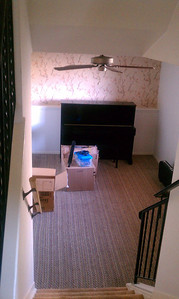 "The piano/family room ""before"" it became loaded with dozens of boxes"