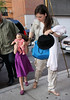 NON EXCLUSIVE<br /> 2011 August 16  - Suri Cruise blocks her face with her doll when coming back to her apartment in NYC. Photo Credit Jackson Lee
