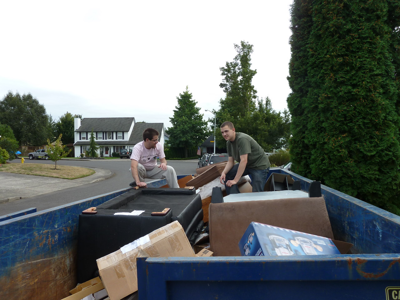 Scott and Ted rearranging the dumpster.