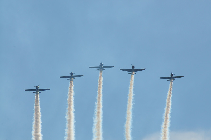"""This was probably my favorite formation flying performance by these guys.  They were flying mostly aircraft were made in Russia and China.  I saw one plane that had the old """"Red Star"""" which used to be the symbol for the former Soviet Union.  I loved how they came in over the crowd like this.  It made for a great photo."""