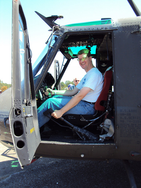 Well of course I can't start my day at an air show without me sitting some of the aircraft on display.  This one of the few places where I can unleashed that little boy that still lives!  I'm sitting in the cockpit of UH-1 Huey Helicopter which was the work horse of the Vietnam War.