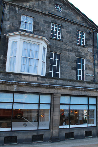 """Because of a window tax of yesteryear, many """"windows"""" are painted over to provide the look of a window without adding another window that could be taxed."""