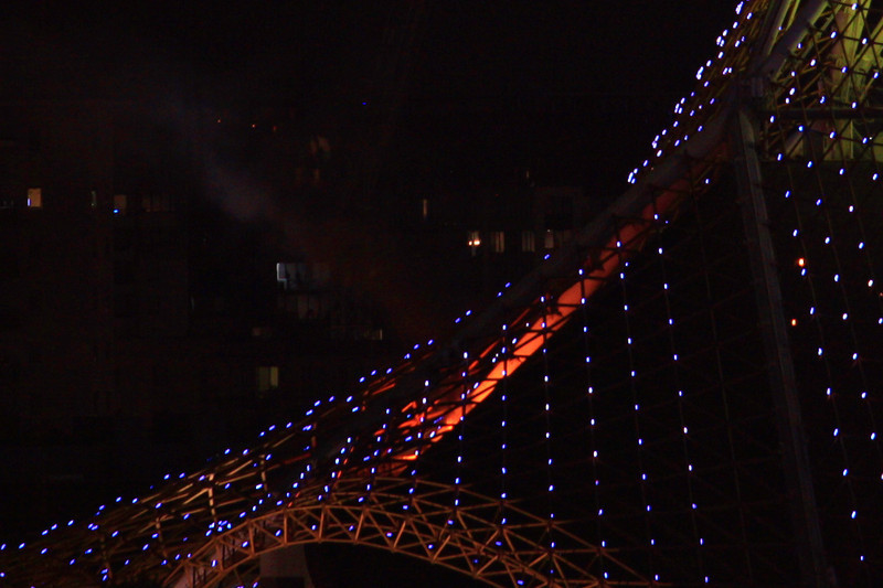A closeup, showing the red glow of the roof fire.