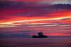 """Sunset at Garry Point Park in Steveston. Silhouette of Fraser River Pile & Dredge's vessel - hopper dredge """"Fraser Titan""""."""