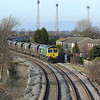 The 6 floodlights of Boothferry Park the former home of Hull City AFC are that is left of the ground and in this view only 3 are visible, Freightliner Heavy Haul's 66585 wait's for a path onto the mainline with 6M51 1243 Hull Coal Terminal - Rugeley Power Station coal working.