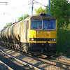 Tanking along at its maximum permitted speed of 60mph 60015 ''Bow Fell'' is about to pass over Balne level crossing with 6d43 1402 Jarrow Shell O.T. - Lindsey Oil Refinery empty tanks.