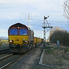 After being engaged on engineering duties overnight between Ferriby and Broomfleet.<br /> 66090 is seen at Broomfleet with 6T80 1500 Brough - Doncaster Up Decoy loaded spoil/empty ballast working thetrain consist's of 6 empty Falcon JNA wagons and 28 MHA coal fish wagons with various ammounts of spoil in them.