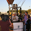 LZCommunityNews.com interviews pilot, Phil Bryant for their site while Jeri Dawn Martin of KXOY radio station awaits for their friday morning media flight at the inaugural Cowboy Veteran's Capital Balloon Flight Festival. Craig and Stephanie Hill of Central Texas Energy Suppliers of Comanche.