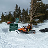 Made it to the pass.  Only one tough spot where the road was drifted so high and steep we couldn't pass.  Had to detour to a steep section, unload sled, and haul each piece up a steep section individually.
