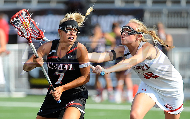 02 July 2011: Under Armour All-America North team midfielder Tatum Coffey (7) drives to the goal against the defense of Under Armour All-America South team midfielder Sloan Warren (16) during the second half at the 2011 Under Armour All-America Lacrosse game played at Johnny Unitas Stadium in Towson, MD.