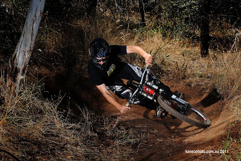 The runin is steep into this berm and most hit it slow with no lean. Not Angus.