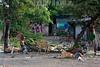 Nicaragua : Vertedero municipal de Managua, denominado La Chureca, alrededor de mil toneladas de desperdicios son arrojados diariamente por los camiones de la Alcaldia de la capital nicarag . Mayor vertedero de basuras de Managua. Esta situado en el extremo nor - occidental de la ciudad, al borde del lago Xolotlan (lago Managua) y rodeado por el barrio de Acahualinca. Churequeros al pie. / Churequeros working in La chureca. Scavenging. scavenger. City dump La Chureca is the municipal domestic and industrial waste-disposal site of Managua. It is the largest open- air landfill in Central America. contraluz. Churequeros working in La Chureca. / Nikaragua: Mülldeponie La Chureca. La chureca in Nicaragua ist heute eine der grössten wilden Müllkippen der westlichen Welt, sprichwörtlich eine Endstation der Zivilisation. Armut. Müllsammler. Müllhalde. Kinderarbeit. © Inti Ocon/LATINPHOTO.org