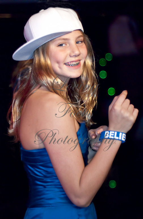 """""""Dual Dimples"""" -- I shoot many events and I love the energy and faces of young and old having a great time. Here, I was shooting in a very dark reception environment. The magic of Nikon strobe technology along with a very fast lens caught what my naked eye could barely perceive."""