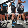 Best legs in the business - Team Sky arrive on the signature podium...