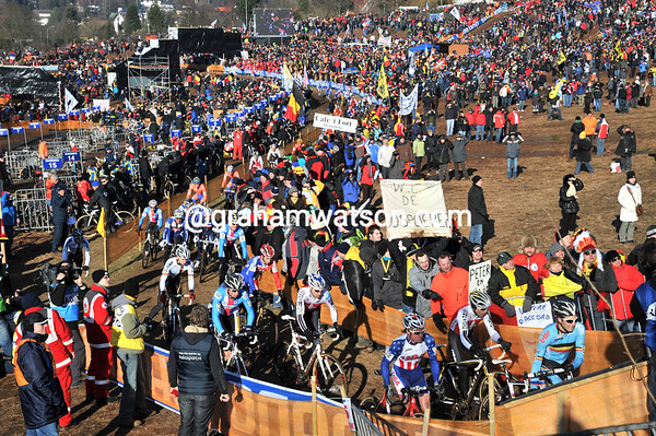 Massive crowds watch the opening lap of the elite mens race...
