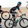 Bradley Wiggins makes a quick wheel-change behind the peloton...