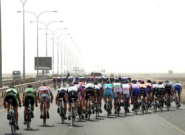 The race is almost reaching speeds of 80-kilometres-per-hour down the highway to Mesaieed to start two circuits in the Qatari desert...
