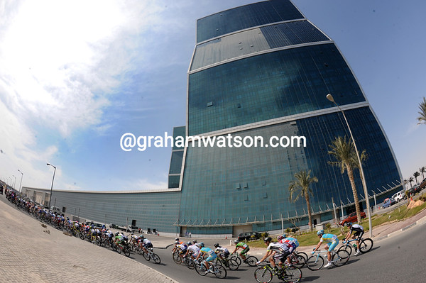 With its almost-clean windows, the West Bay Lagoon building towers proudly over the Tour of Qatar...