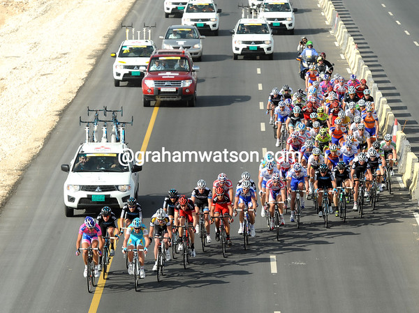 The spearhead of the chasing group pounds down the highway to Doha - they still have a minute to take back off the escape...
