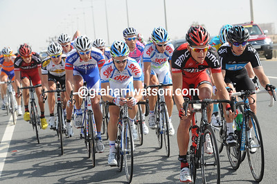It's become a strong headwind now - a 20-man escape develops led by Greg Van Avermaet and Russell Downing...
