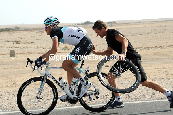 Wouter Wylandt makes a wheel change and gets back without too much trouble...
