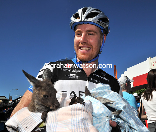Not known for any vegetarianism, Tyler Farrar holds two Joeys in his arms...