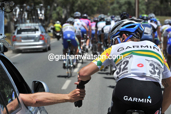 Even Australian champions have to work today - Jack Bobridge fills up with cool water...